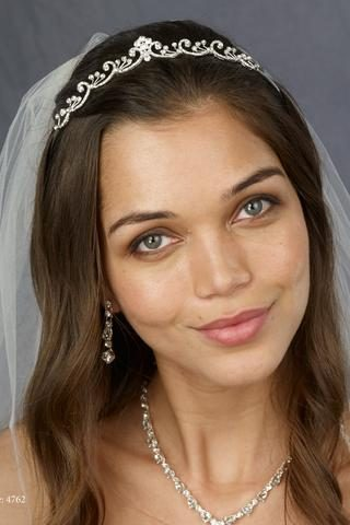 woman showing off wedding jewelry from symphony bridal
