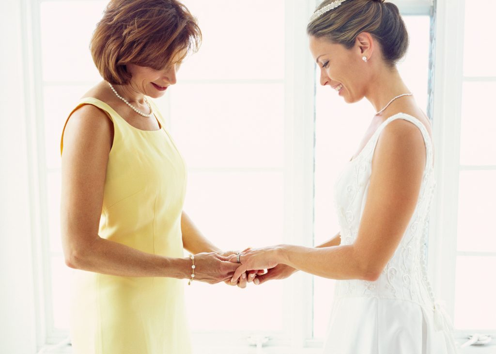 portrait of a bride and her mother adjusting a ring