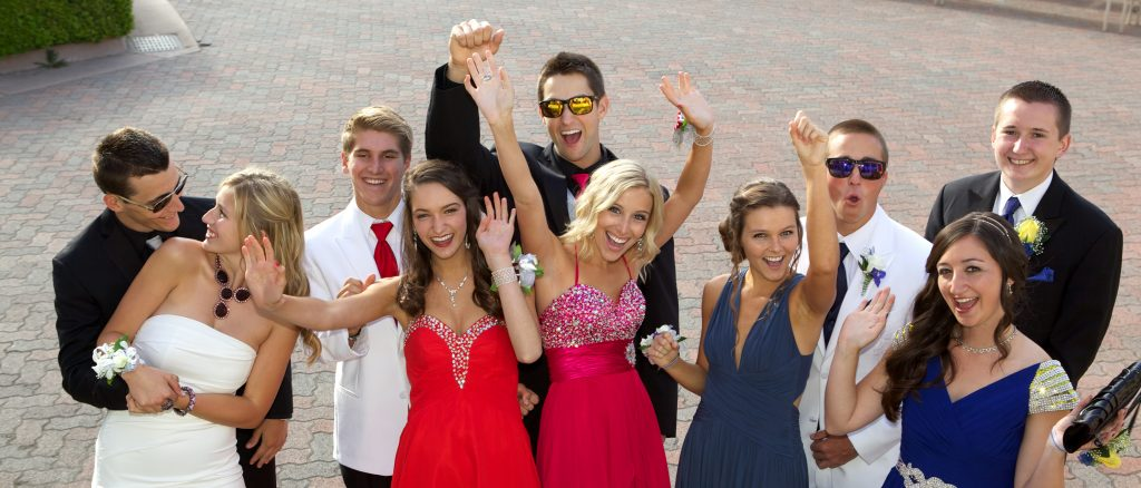 group of high school teens excited for prom